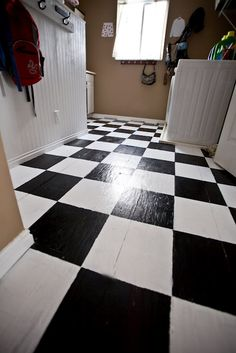 Same plywood floor~~~'checkerfied'!   LOVE it!!!   {but I would do a different color combo, black and white would not look good in my home}