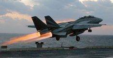 F-14 Tomcat catapult takeoff with afterburner from NAVY Aircraft Carrier.
