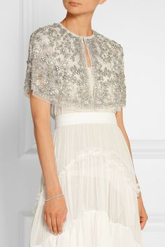 Ivory tulle Concealed hook fastening at front 100% nylon; trim: 93% cotton, 7% nylon; lining: 100% nylon Dry clean Imported