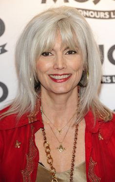 Emmylou Harris rocks grey hair like she rocks the guitar. The all-grey songstress ages gracefully with this bangs-and-layers look.
