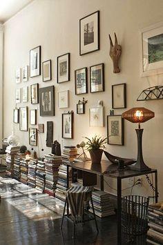 Stacked books in lieu of bookshelf.  designer Scott Newkirk Brooklyn apartment