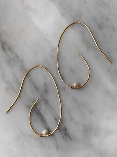 Hand formed, feminine sculptural earring with freshwater pearl accent. Also available in sterling silver. Minimal Jewelry, Fresh Water, Jewelry Design, Hoop Earrings, Feminine, Sculpture, Pearls, Sterling Silver, Handmade