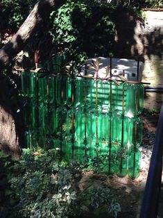 My Recycled Plastic Bottle Fence Project  You Will Need:  --Four-foot lengths of rebar  --Empty 2-liter bottles of Mt. Dew or Ginger Ale    --Forstner bits to drill holes in bottles --Ornamental fence toppers upon completion