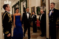 Honorable Mention  For the annual Kennedy Center Honors on Dec. 4, 2011 in Washington, Obama chose a strapless blue gown designed by Vera Wang.