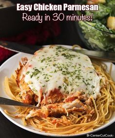 Easy Chicken Parmesan Recipe ~ An easy recipe  that's ready in 30 minutes! Served over pasta, this chicken parmesan with melty mozzarella and marinara is a family favorite!