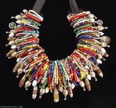 This would be an amazing necklace. You could use up all your 'orphan' beads. What a fun look. It looks like loops of beads with a focal bead all strung on a ribbon. Textile Jewelry, Tribal Jewelry, Boho Jewelry, Jewelry Crafts, Jewelry Art, Beaded Jewelry, Handmade Jewelry, Beaded Necklace, Jewelry Design