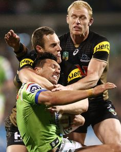 Jordan Rapana of the Raiders is tackled by Isaah Yeo and Peter Wallace of the…