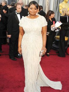 The Help favorite Octavia Spencer, wearing a Tadashi Shoji gown and Jimmy Choo shoes, also inlcuded Neil Lane jewels and a Judith Leiber clutch in her red carpet look. (Working to find a picture that demonstrates how stunning she really looked!)