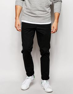 """Chinos by ASOS Soft- touch cotton Button fastening Side slash pockets Two back pockets Tapered fit - cut loosely around the thigh and tapered from the knee to the ankle Machine wash 100% Cotton Our model wears a 32""""/81 cm regular and is 185.5cm/6'1"""" tall"""