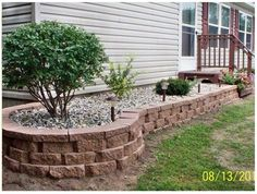 Landscaped the entire length of the home for a beautiful mobile home improvement!