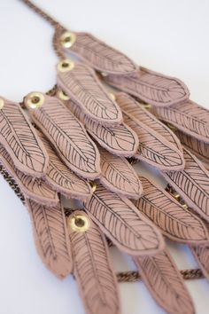 pale rose soft leather feather amulet necklace
