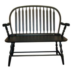 Handcrafted wood bench with turned detail and an antiqued black finish.           Product: BenchConstruction Material: