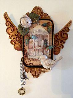 Bird with birdcage in Altoid tin shrine