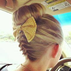 backward french braid into a bun, finished with a cutesy bow - I love!