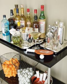 For a laid-back affair, keep the food and drinks simple. Here, Kevin set up a bar in the dining room. Guests can help themselves by mixing a drink or pouring Champagne.
