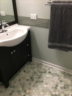 Great bathroom paint Sherwin Williams Rainwashed Bathroom Paint Color by  Tonia B Floating shelves