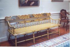 Archive Photo: Object ID: X.0548 Antique American (per Eldred & Co. - 09-10-2012) Sheraton; painted mustard yellow settee with three chair backs. Top rail re-stenciled with blue grapes and green leaves and gilded decoration; back cross pieces are decorated similarly.  Fifteen turned spindles under cross piece. Gift of John & Elliott K. Blaisdell and their mother. June 1981.  Once owned by John Emory and his daughter, Mary Atwood Emory Blaisdell. #atwoodhouse, #setee,