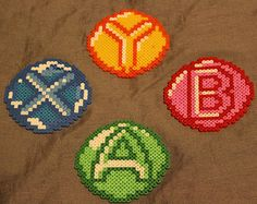 Set of Xbox 360 Button Hama Bead Coasters. would cross stitch instead of hama beads though.