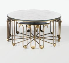 'ONDULATION', A GILT METAL AND MIRROR COFFEE TABLE AND FOUR NESTING TABLES BY JEAN ROYÈRE, CIRCA 1950