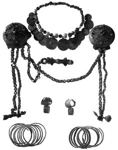 Convex round shoulder brooches and other ornaments characteristic of womens dress in western Finland during the Viking Age. Grave no.  56, Luistari cemetery in Eura, Satakunta.