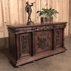 Antique Furniture ~ 19th Century French Walnut Neoclassical Buffet features carved embellishment influenced by the Renaissance and Baroque styles. Circa 1870