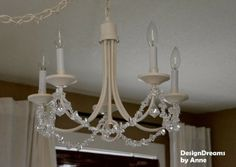 How to makeover a chandelier with some paint and bling