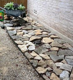 This is my side yard, still working on it. The stone use to be the path, but terrible to bring out the trash can.