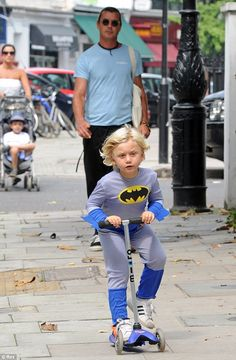 Batman and his bat mobile. Gavin Rossdale and his son out for a scoot on a Mini Micro scooter. #minimicro #microscooter