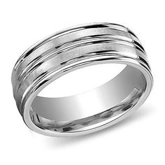 This will be the ring that my groom will wear as his wedding band. I love the bold stripes on it because I don't like things to be too intricate for a man's ring. I will have it made in platinum.