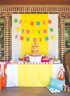 Bright & Modern Popsicle Party - DIY Popsicle Garland backdrop made from pool noodles!