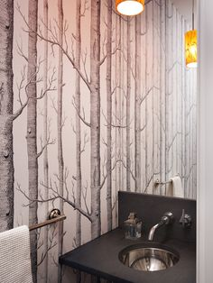 Clever use of wallpaper, mirror and lighting to make this tiny bathroom feel as though it extends into the distance