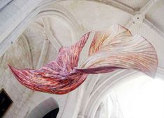 Must see these giant paper flowers inside Abbey Church in France- artist Peter Gentenaar-image from   weburbanist.com