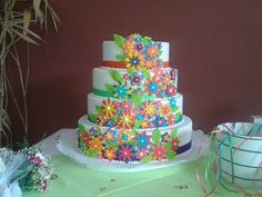 Colorful flowers wedding cake - for a happy and relaxed celebration during the day.
