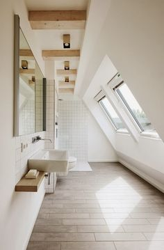 Beautiful bathroom. This is perfect. I want the natural light, light-colored wood, exposed beams, and the peaceful white.