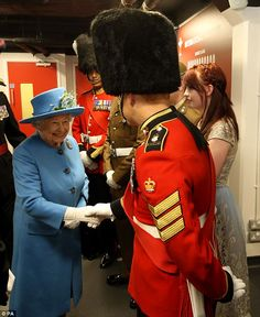 Tiny: The Queen was dwarfed by some of the soldiers - particularly those in towering bears...