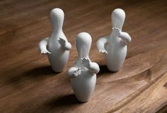 Bowling pins with hands. But of course! $30