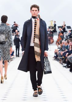 Burberry Spring/Summer 2016. Dark indigo sculpted trench, made in Italy knitted stripe tie and The Barrow in graphic print