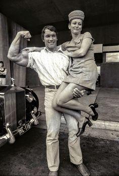 Arnold Schwarzenegger lifts Ansett hostess Roslyn Hull off the ground ...