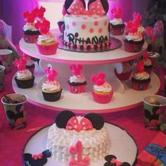 minnie mouse cake with cupcakes and smash cake
