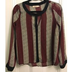 Long sleeve blouse with cut out detail Patterned long sleeve blouse with cut out detail by the neck. Looks great either buttoned up or not! Tops