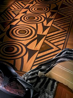 """Berti Wood Flooring. Decorative parquetry model Tam Tam. Timber floors. And more. In this subject, the symbols and motifs typical of African culture are developed to form a vertical """"totem"""",   a panel forming an original furnishing idea, even for the walls of a room. #parquet #parquetlovers"""