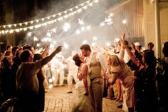 Night time wedding getaway with sparklers. Mother of the groom is too funny here!