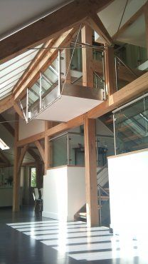 Stunning use of engineered oak with stainless steel bow-tring trusses