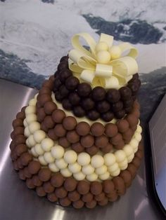 A mixed Lindt truffle wedding cake.oh sweet Lindt Chocolate, Chocolate Truffles, Chocolate Desserts, Sweet Recipes, Cake Recipes, Dessert Recipes, Lindt Truffles, Yummy Treats, Sweet Treats