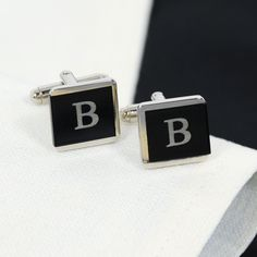 Designed with distinction, our Two-Tone Tuxedo Cuff Links offer a refined look at an affordable price.  With their sleek design and custom appeal, these tuxedo treasures will finish off any man's formal wear with a touch of class and just the right amount of polished elegance.  Edged on three sides with a brushed silver trim, you can suit up everyone from groomsmen and guy friends to fathers and fraternity brothers with these debonair accessories.