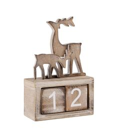 Countdown advent calendar A beautiful white washed wooden advent calendar block topped with a mother and baby reindeer. This lovely Christmas decoration lets you anticipate the countdown to Christmas by turning over its 2 blocks to countdown the days left until Christmas day. A great children's bedroom decoration, which allows them to eagerly watch the days of December commence. WoodWidth: 9cm Height: 14cm Depth: 4cm
