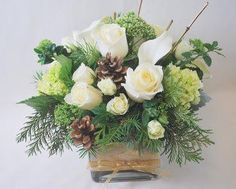 White roses, green hydrangea, callas lilies and mini spray roses, with a hint of gold accents