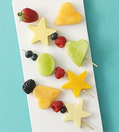 Make fruit kabobs for a healthy Valentine's Day party snack.  Swap out the stars for X's and O's and use red strawberries and white apples for a festive look.