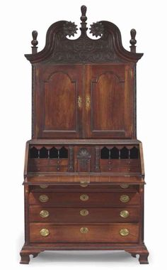 A CHIPPENDALE CARVED CHERRYWOOD DESK-AND-BOOKCASE - LANCASTER, PENNSYLVANIA, CIRCA 1785 - 92 1/2 in. high, 42 1/4 in. wide, 22 1/8 in. deep. Provenance: Israel Sack, Inc., New York, Mr. and Mrs. Bertram Dawson Coleman, Bryn Mawr, Pennsylvania