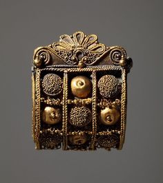 6th C. BCE . Etruscan Gold Earring with granulation and organic forms.